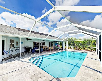 Canal-Front Home w/ Solar-Heated Pool, Fire Pit, Big Yard & Private Boat Dock - Caloosahatchee