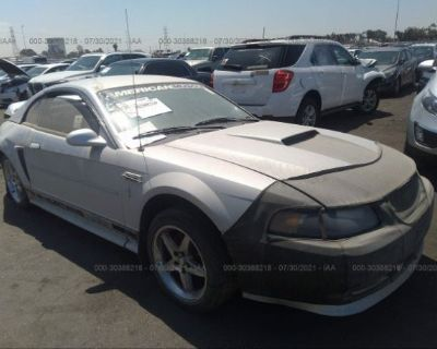 Salvage Silver 2000 Ford Mustang