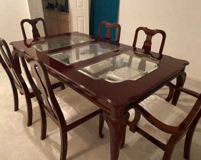 Dining room table, cherry wood with glass inserts, off white fabric chairs
