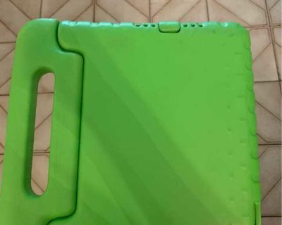 Rose Gold iPad OS 13.3.1 with green cover