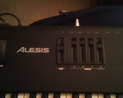 Selling A Alesis QS8 64-Voice/88-Master Controller Synthesize Keyboard With Protec Soft Case