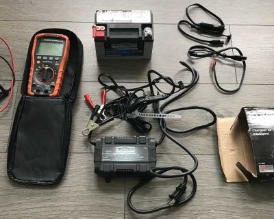 Multimeter, 12 V battery, and charger