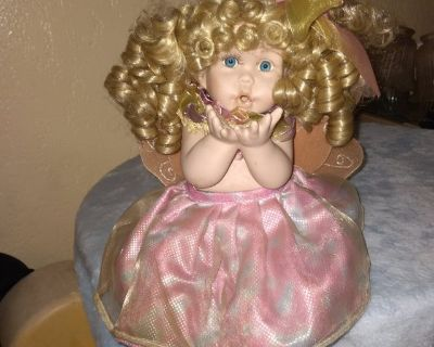 Porcelain doll with angel wings