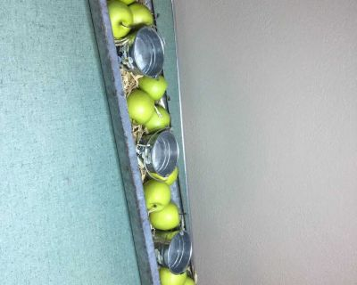 Vintage galvanized chicken feeder with candles in little hand painted buckets with apples