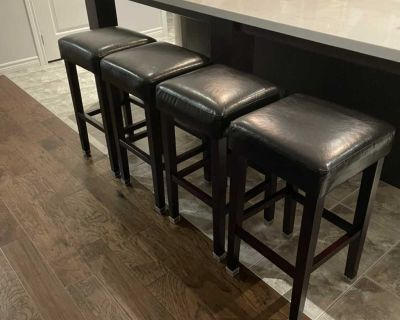 Four counter height bar stools